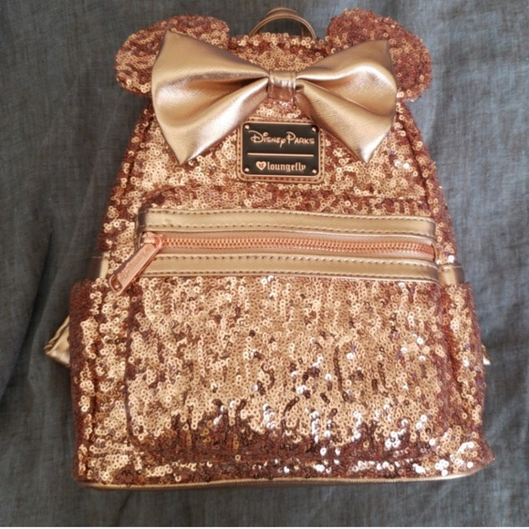 a8001b2e3ab Loungefly Handbags - Disney LoungeFly rose gold sequin backpack
